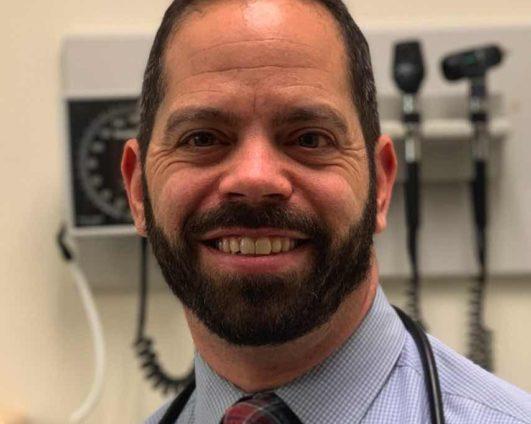 Dr. Asher Marks